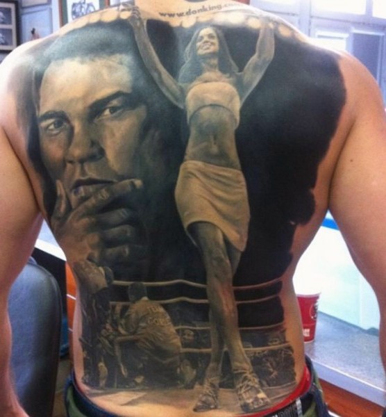 Very realistic looking black and white boxing themed tattoo with Muhammad Ali portrait tattoo on whole back