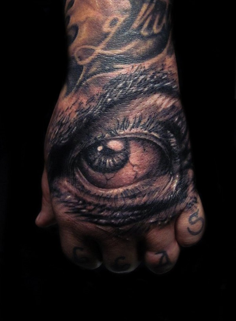 Very realistic looking black and white evil eye tattoo on hand