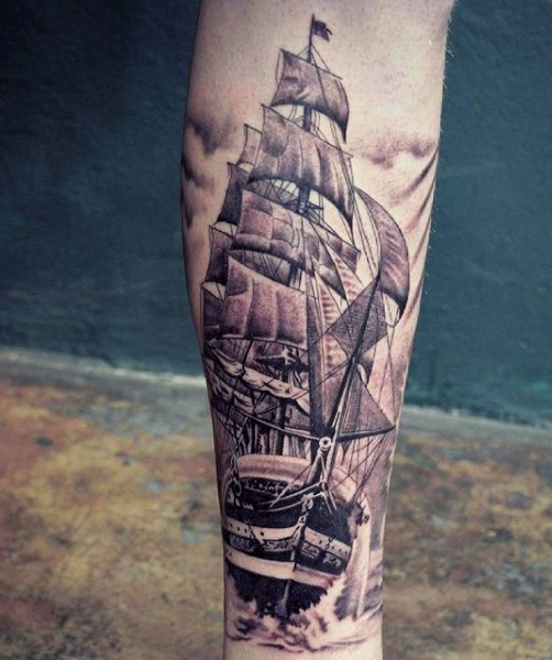 Very realistic looking black and white old ship tattoo on leg