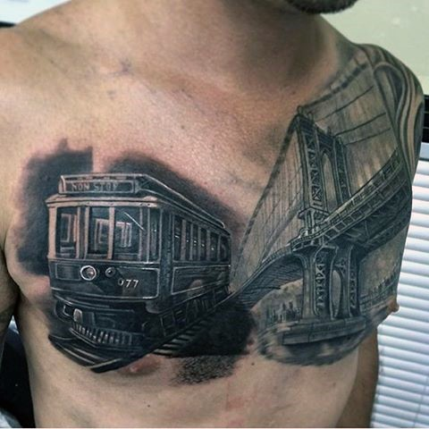 Very realistic looking black and white old train with mountain tattoo on chest