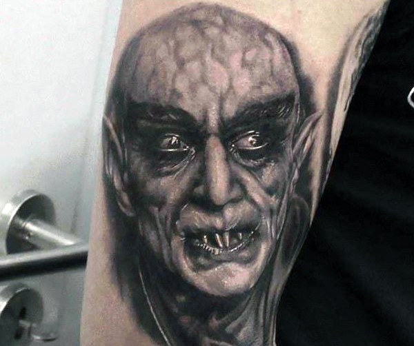 Very realistic looking black ink old horror movie hero tattoo on arm