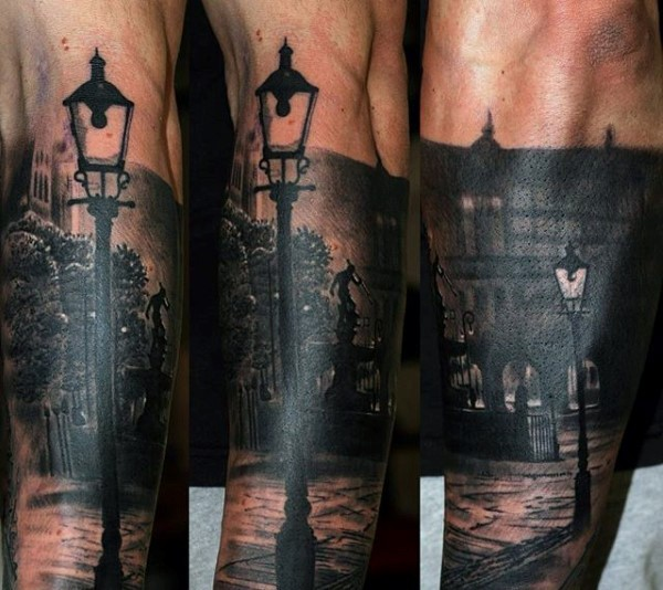 Very realistic looking black ink photo like old night cite tattoo on forearm zone
