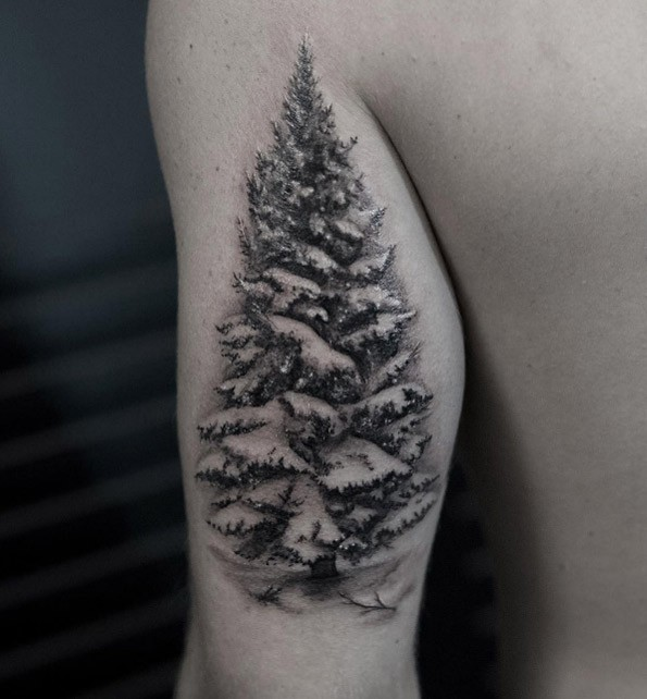 Very realistic looking colored upper arm tattoo of big tree with snow