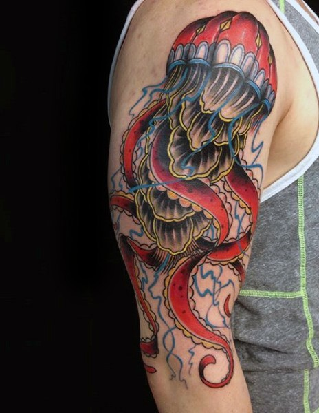 Very realistic looking colorful big jellyfish tattoo on half sleeve area