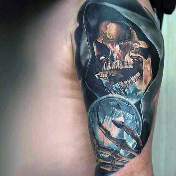 Very realistic looking colorful skeleton wizard with orb tattoo on shoulder