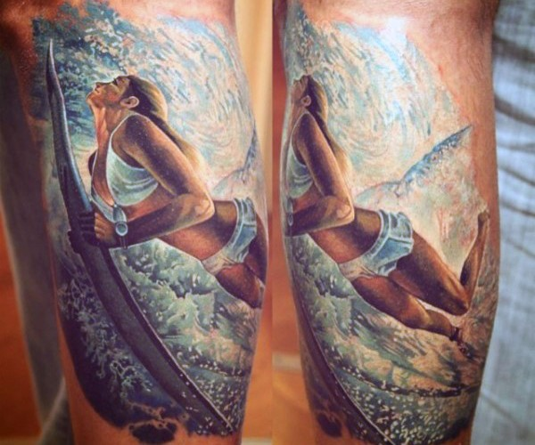 Very realistic looking cute woman surfer tattoo on arm
