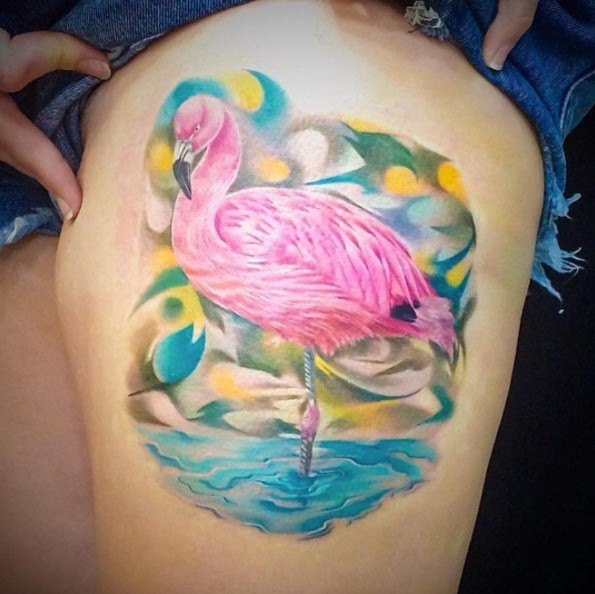 Very realistic looking detailed thigh tattoo of pink flamingo in water