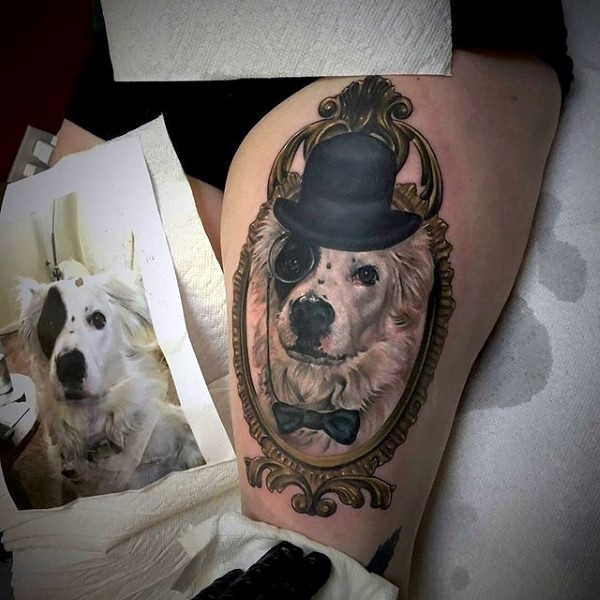 Very realistic looking multicolored gentleman dog portrait tattoo on thigh