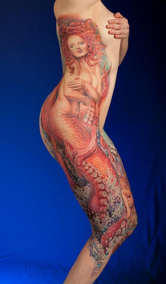 Very realistic looking natural colored seductive mermaid tattoo on whole body