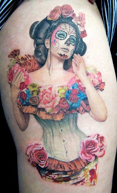 Very realistic looking nice colored Mexican woman with flowers tattoo on thigh