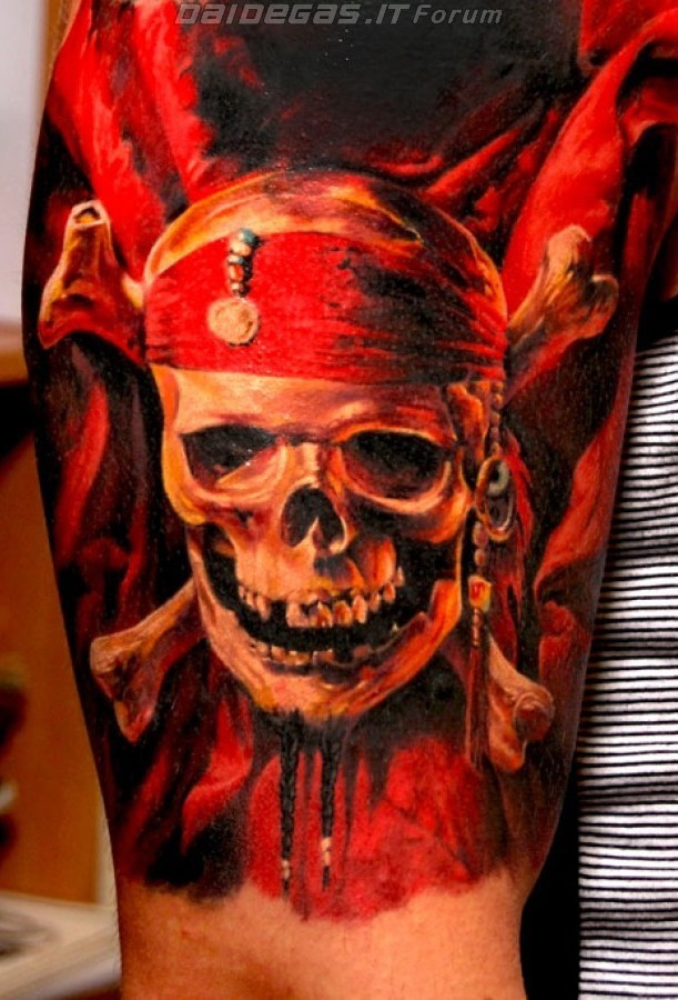 Very realistic massive colored pirate emblem skull tattoo on arm