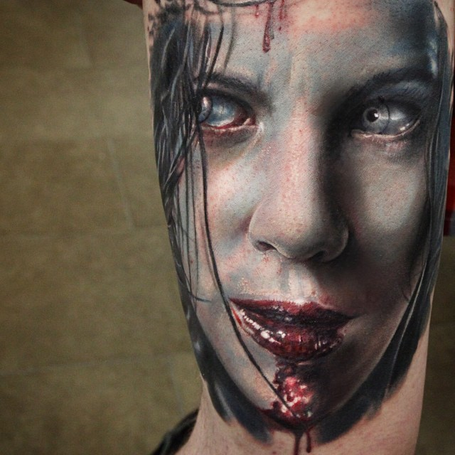 Very realistic painted and colored bloody vampire movie woman hero tattoo on arm