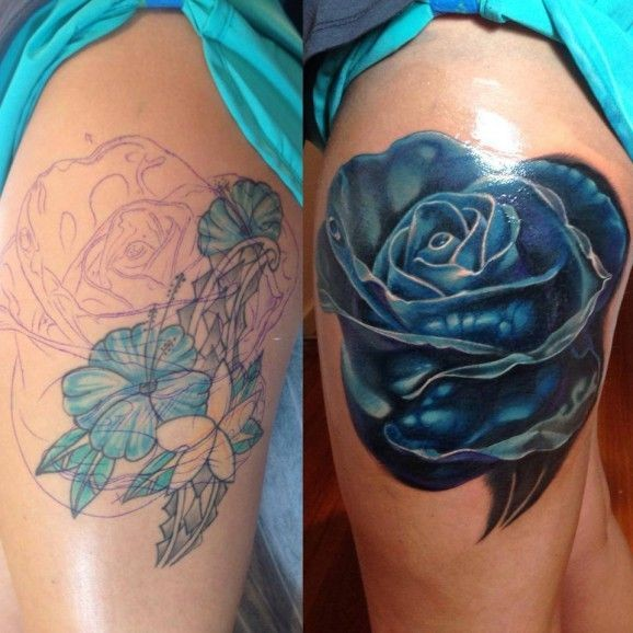 Very realistic painted massive blue rose tattoo on thigh