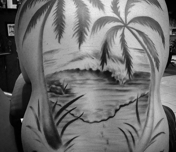 Very romantic looking black and white island shore tattoo on whole back