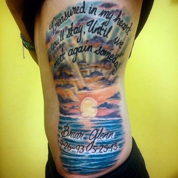 Very romantic looking colorful ocean sunrise with lettering tattoo on side