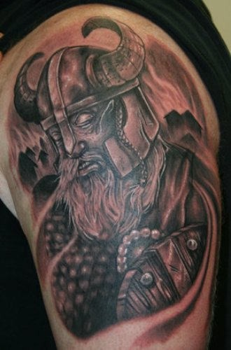 Viking in armor tattoo on half sleeve