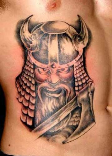 Viking with ax tattoo on ribs