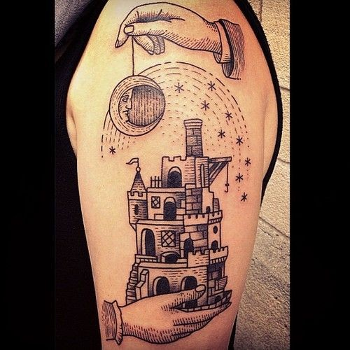 Vintage black ink fantasy castle tattoo on shoulder stylized with moon and stars