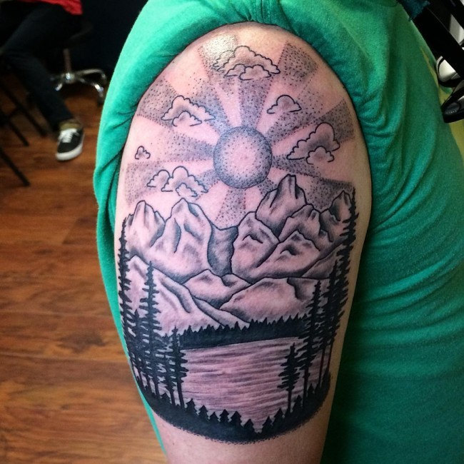 4d130d35d Vintage black ink lake tattoo on shoulder with mountains and sun