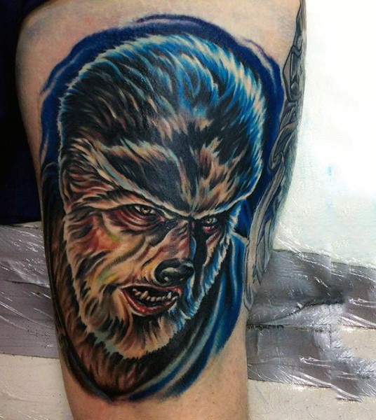Vintage horror movie themed colored thigh tattoo of werewolf