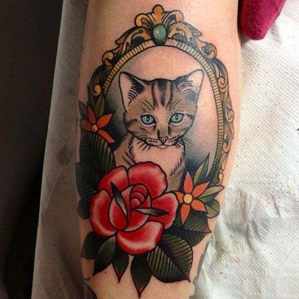 Vintage like colored tattoo of cat portrait with flowers