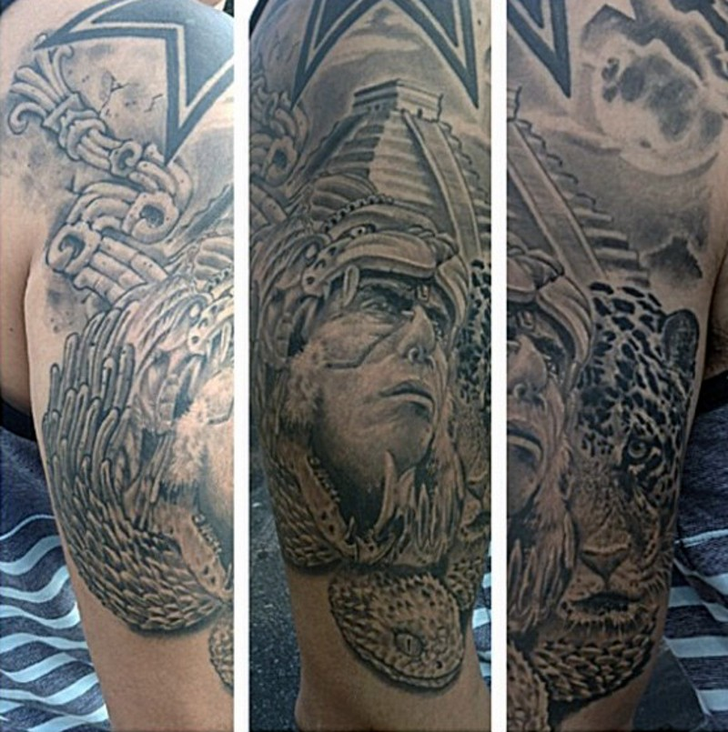 Vintage movie like black ink tribal man portrait tattoo on shoulder combined with big temple and leopard