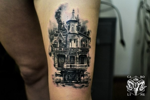 Vintage photo like black and white thigh tattoo of old house