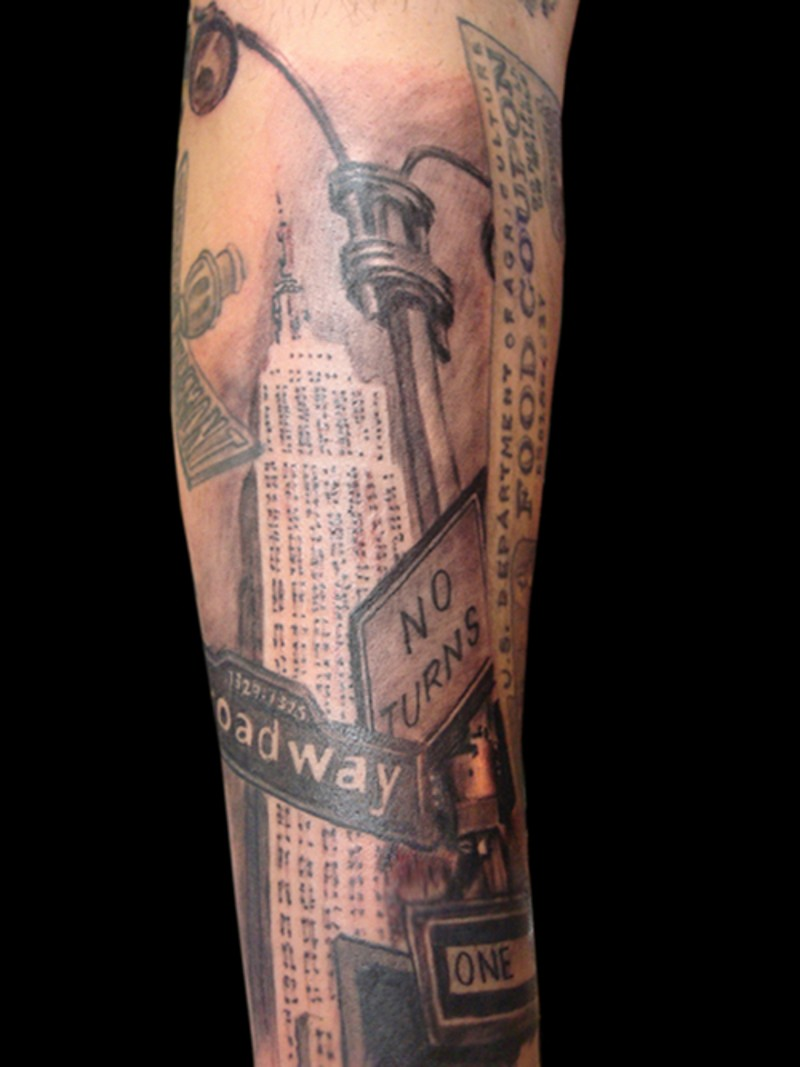 Vintage photo like colored forearm tattoo of American city sights