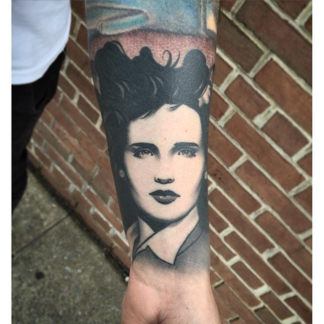 Vintage photo like portrait style tattoo painted by Michael J Kelly on forearm