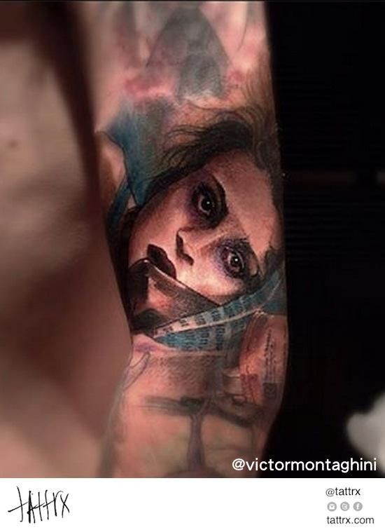 Vintage picture style colored forearm tattoo of woman face