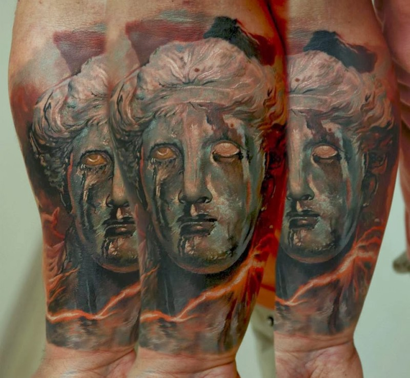 Vintage picture style colored forearm tattoo of fantasy ancient statue