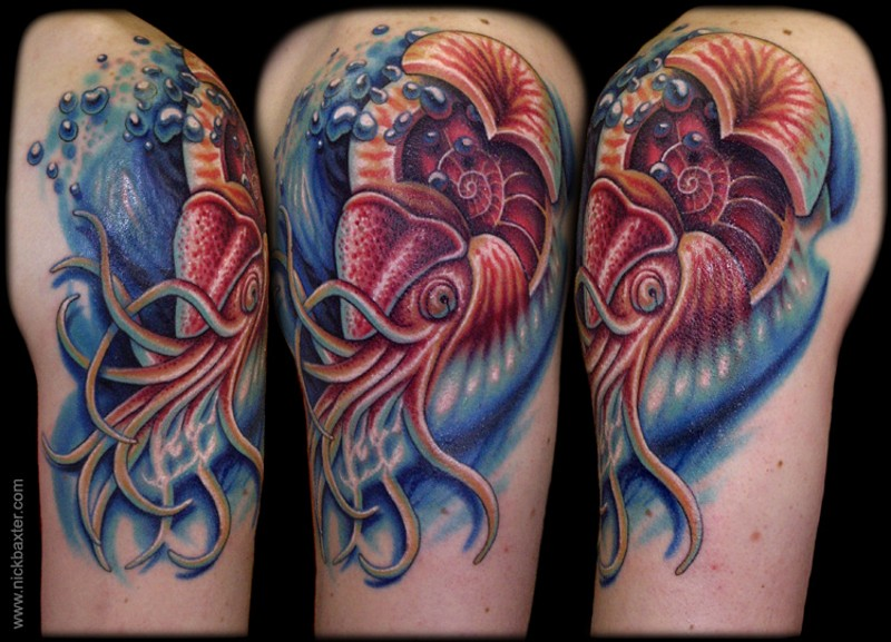 Vintage picture style colored shoulder tattoo of squid in waves