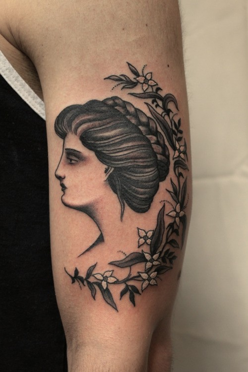 Vintage picture style colored shoulder tattoo of woman portrait with flowers