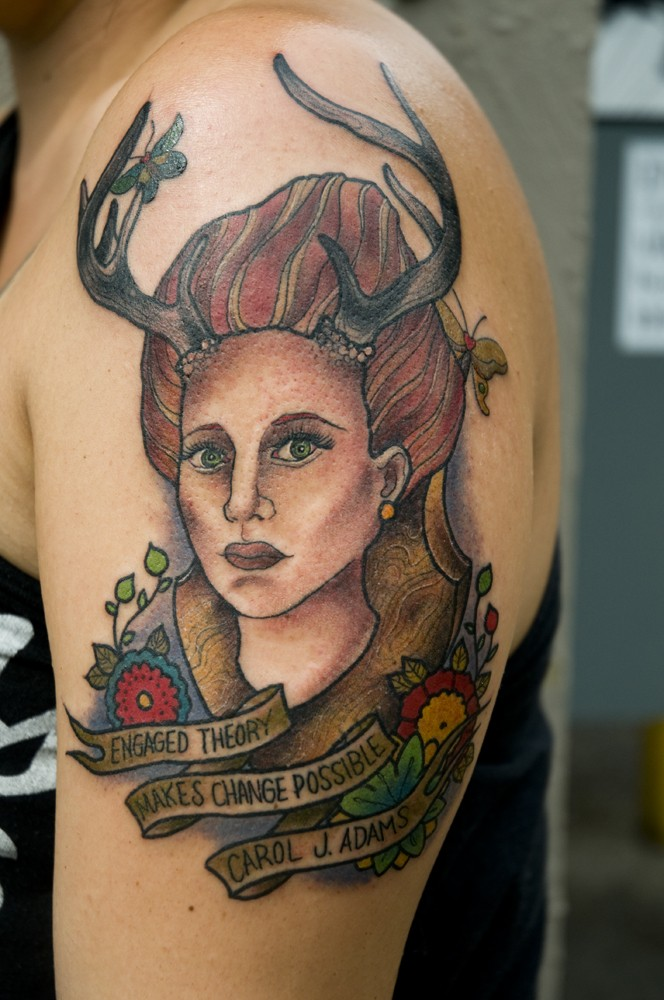 Vintage picture style colored shoulder tattoo of woman with horns and lettering