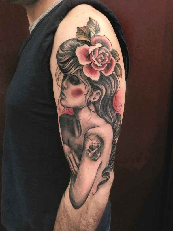Vintage picture style colored shoulder tattoo of woman with flowers and skull