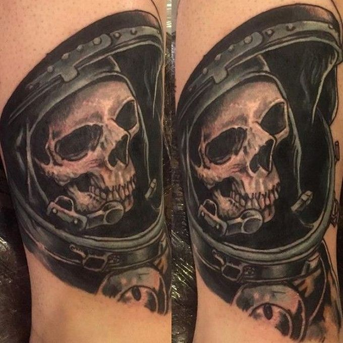 Vintage picture style colored shoulder tattoo of astronaut skeleton