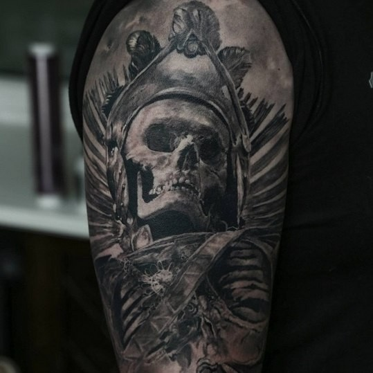 Vintage picture style detailed shoulder tattoo of ancient tribal skull