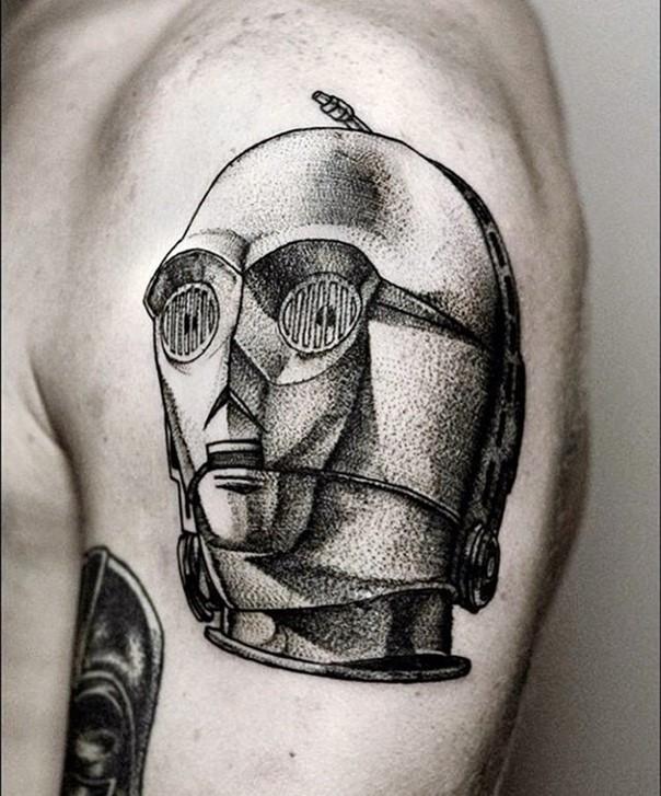 Vintage portrait like colored C3PO portrait tattoo on shoulder area