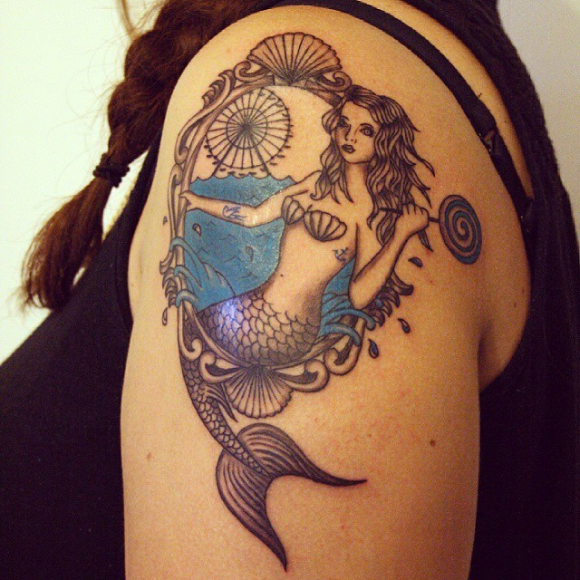 Vintage portrait like colored mermaid with lollypop tattoo on shoulder stylized with ferris wheel