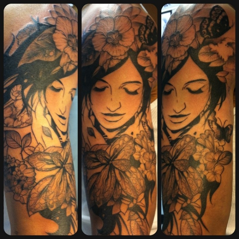 Vintage style accurate painted black and white beautiful woman portrait tattoo on half sleeve stylized with various flowers