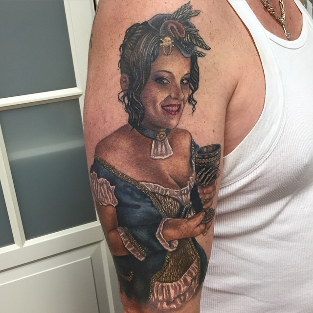 Vintage style beautiful painted and colored shoulder tattoo of woman in nice dress