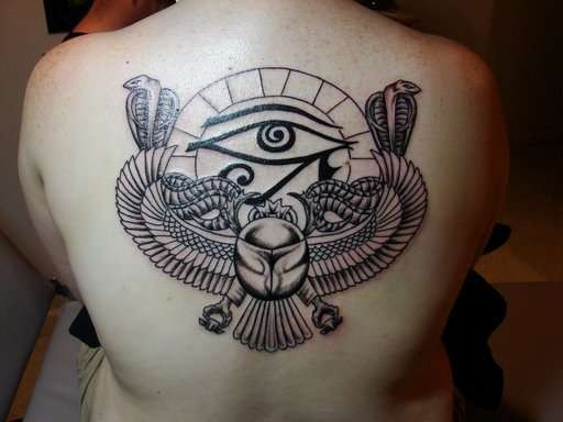 Vintage style black and white Egypt themed tattoo on back stylized with the Eye of Horus