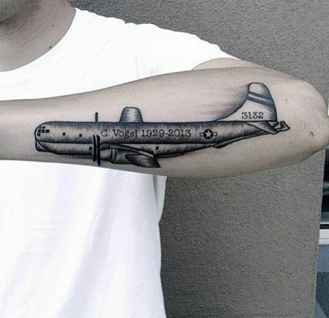 Vintage style black and white forearm tattoo of big plane