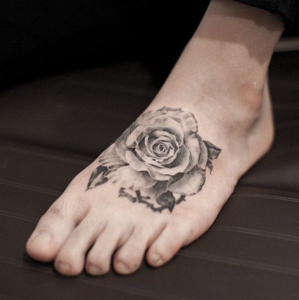 Vintage style black and white rose flower tattoo on foot