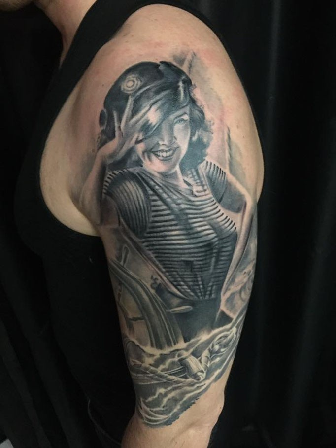 Vintage style black and white shoulder tattoo of woman sailor