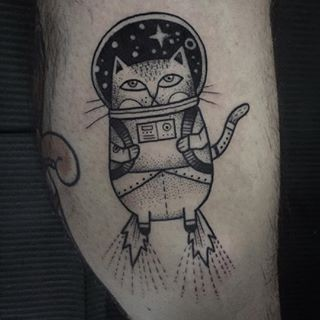 Vintage style black and white tattoo of funny space cat