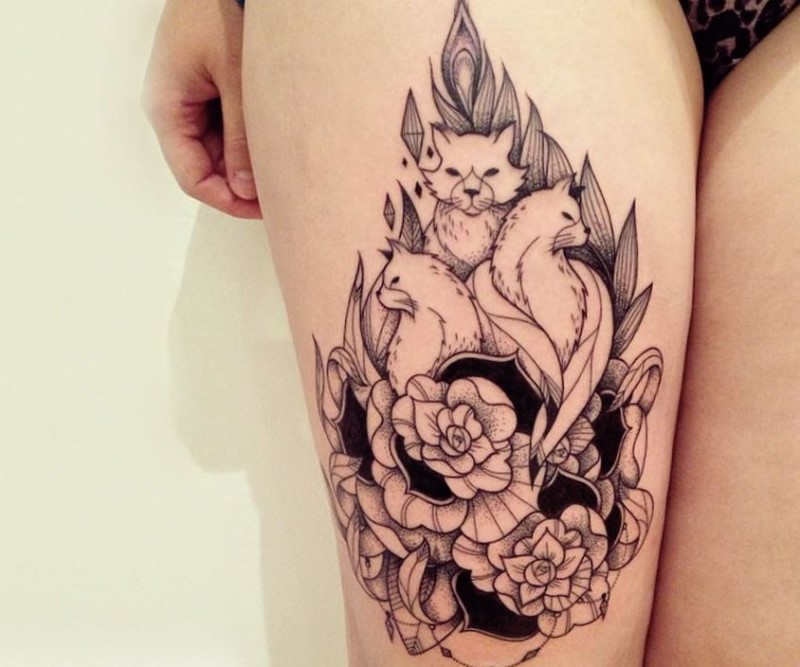 Vintage style black and white thigh tattoo of various cats and flowers
