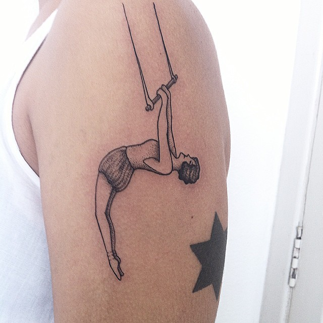 Vintage style black ink acrobat woman tattoo on shoulder