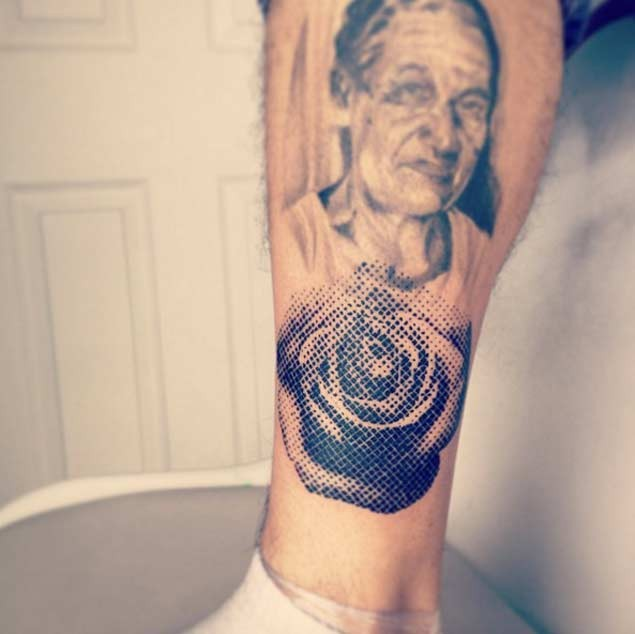 Vintage style black ink leg tattoo of old woman portrait with rose