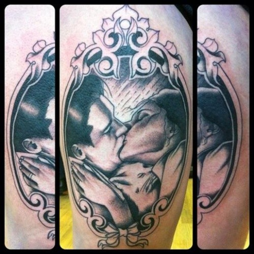 Vintage style black ink shoulder tattoo of kissing couple portrait with white cat